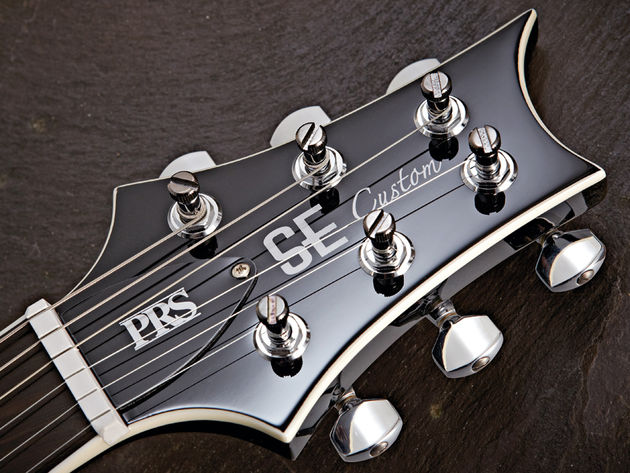PRS's high-quality enclosed locking tuners aid tuning stability.