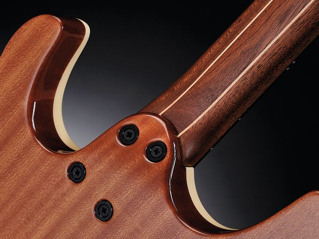 The GTM6's maple-mahogany neck bolts to a tapered heel for easy access.