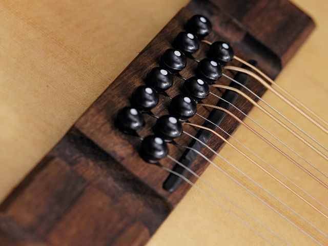 The VE8000PB-12's dedicated 12-string bridge design is reinforced for extra strength.