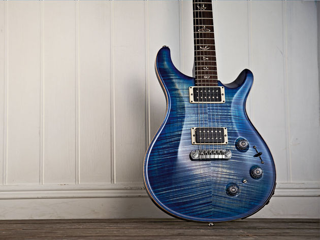 The faded finish almost looks aged in the way the plain maple pokes through the blue stain