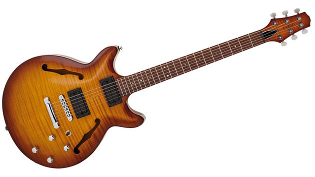 It's certainly well finished with a dark brown 'burst to the maple top - with PRS-like natural maple edge