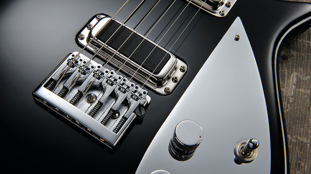A flat-mount Schaller bridge ensures better tuning stability than vintage Rickys
