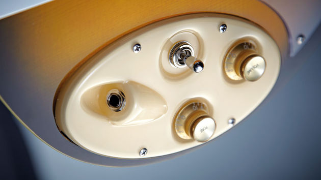 The cream plastic control plate is height and angle adjustable