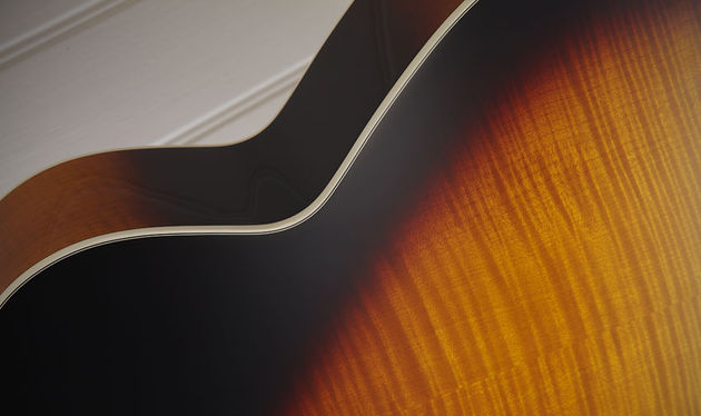 The Series 6 specification goes for solid spruce top with solid flame maple back and laminate flame maple sides