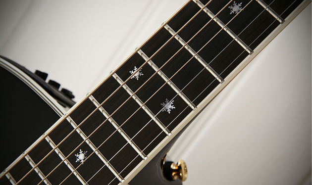 The 644mm (25.3-inch) scale neck has a white- bound ebony fingerboard with mother-of-pearl 'snowflake inlays