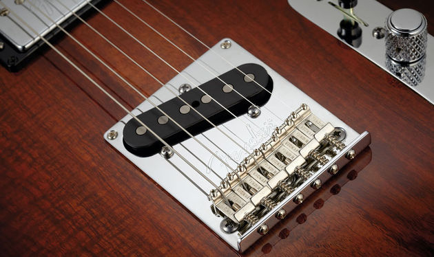 Designed to give a little more Strat-like response, these six bent-steel saddles also allow individual string height and intonation adjustment - increasingly common on Fender's non-vintage Teles