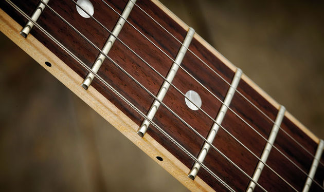 This new and seemingly unique neck construction 'inlays' the rosewood fingerboard into the maple neck. It looks smart and feels superb