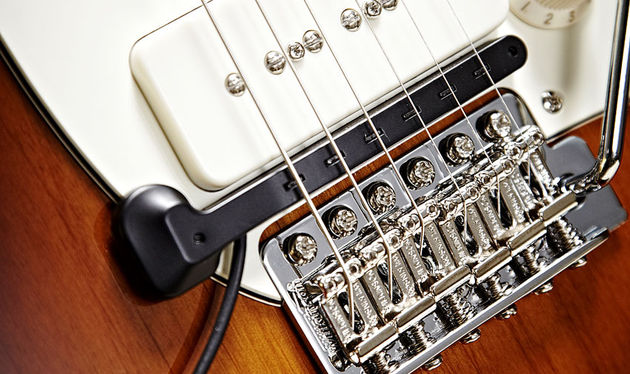 The TriplePlay divided pickup is easily affixed to any guitar with no modifications needed