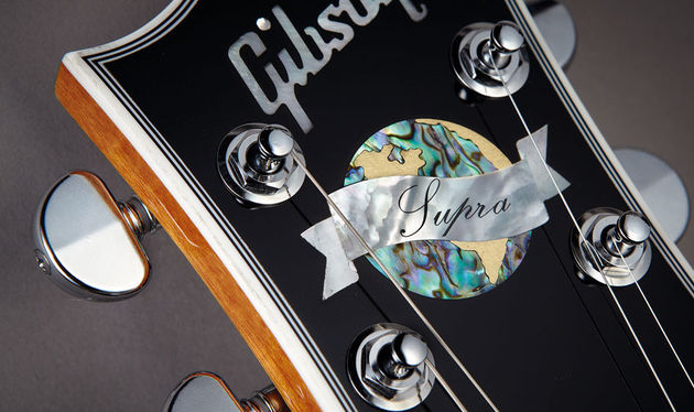 The Supra's abalone headstock inlay underlines a high-end vibe within the Custom-style bound headstock