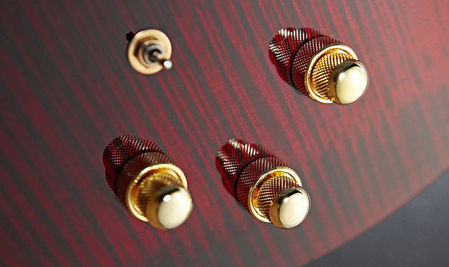The stacked controls include a volume knob that handles MIDI and piezo sounds