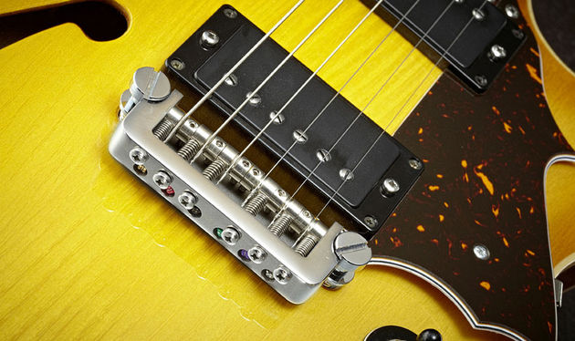 GSG's proprietary bridge design is anchored by two large posts, like a wrapover bridge but featuring six height- and intonation-adjustable saddles