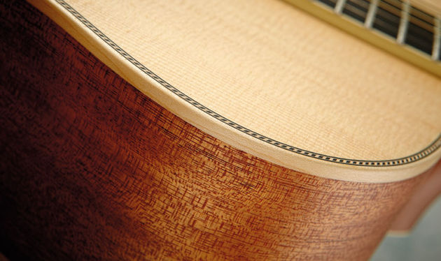 The OM-40 features mahogany back and sides and solid maple binding