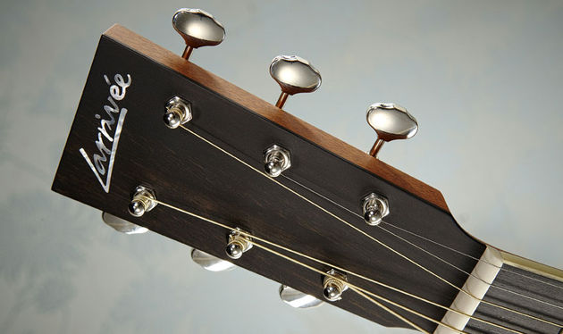 The headstock is simplistic with just an inlaid mother-of-pearl logo and open-backed Gotoh tuners