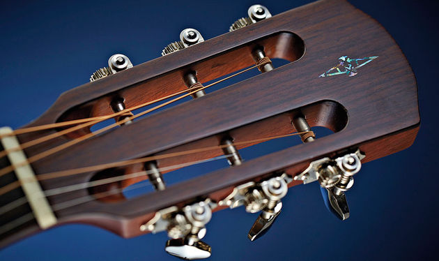 The slot headstock will make restringing a little trickier but also increases the behind the nut string angle