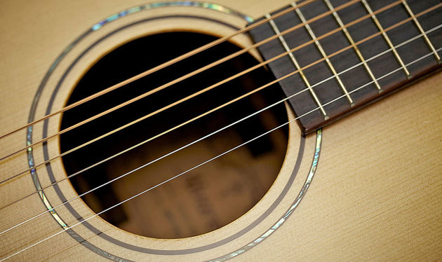 The outer abalone soundhole ring, along with 12th fret and headstock inlays, underlines the subtle class of this guitar