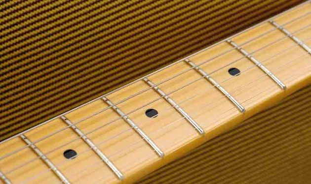 The comfy D-shaped, satin-finished neck is one-piece maple