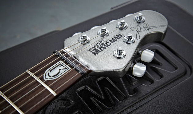 The guitar features Music Man's familiar compact 'four-and-two' headstock