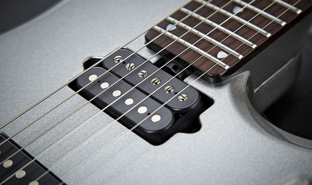 "Petrucci's Illuminator pickups contribute a ""dynamic, liquid"" feel to the tone"