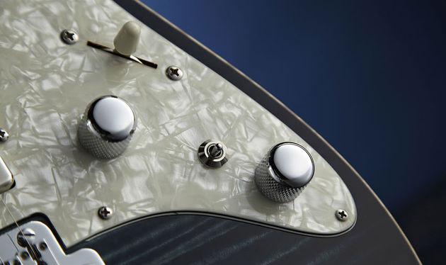 The three-way toggle splits the bridge 'bucker or adds some passive mid-boost