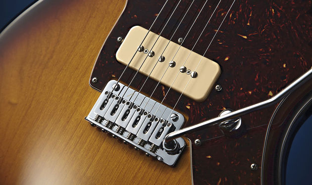 While the shape is Jazzmaster-esque, the vibrato unit is far less temperamental