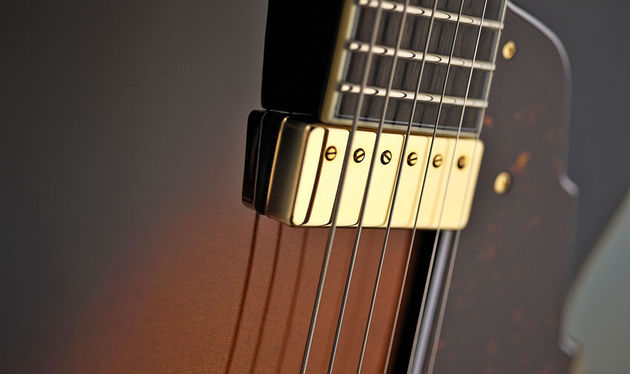 This floating Kent Armstrong pickup attaches to the pickguard, not the neck or the top of the guitar