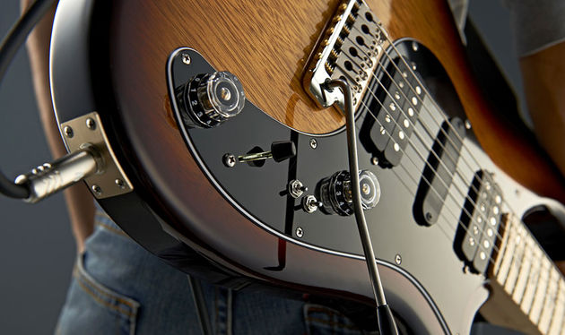 The two mini-toggles switch the two humbuckers between no-volume-drop dual and single-coil mode