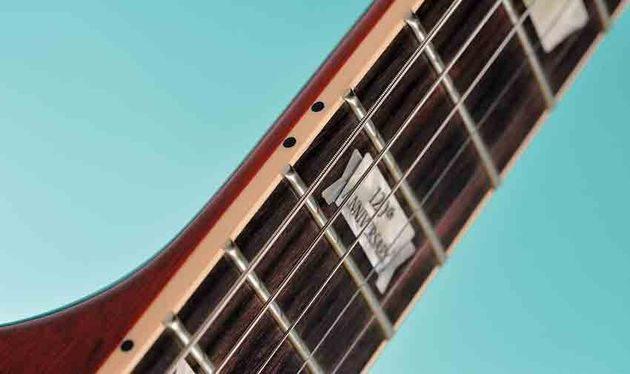 There's a 12-inch-radius rosewood 'board and Gibson 120th Anniversary inlays