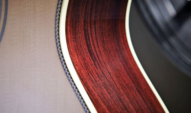 Herringbone purfling surround the soundhole and front