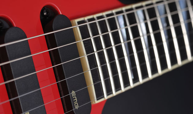 The 24 frets are adorned by mother-of-pearl shark-fin inlays
