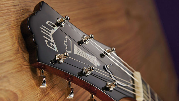 Guild's classic 'centre- raised' headstock appeared around 1962, and replaced the previous Gibson-like 'lip top' design
