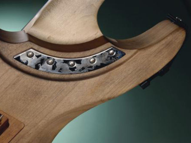 That unique neck join allows for superior upper fret access