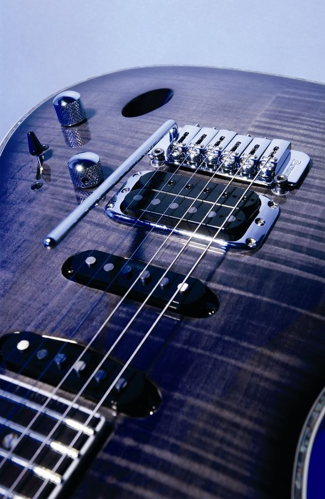 The guitar features an unbound fingerboard.