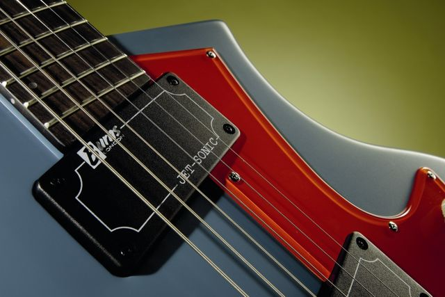 The blue finish option sports a bright scarlet pickguard