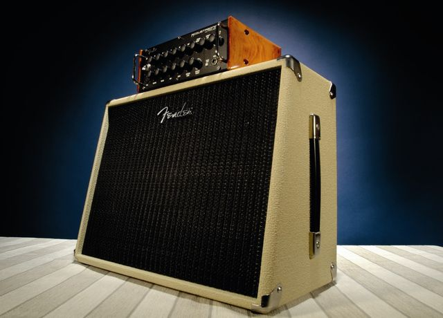 The amp head blends style with a tank-like construction