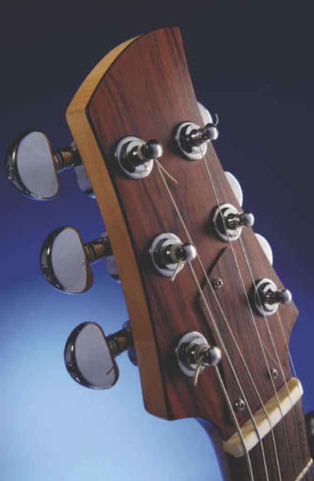 The minimalist headstock is just big enough to fit the tuners on
