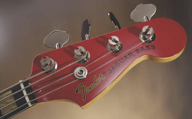 The headstock features classic open-geared tuners