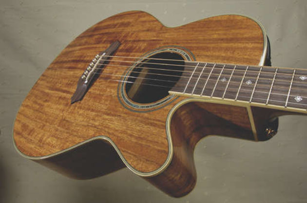 Takamine's EF508KC boasts a laminated koa top