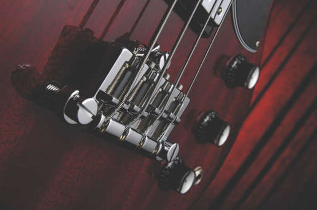 The newer combo type bridge offers greater string adjustment
