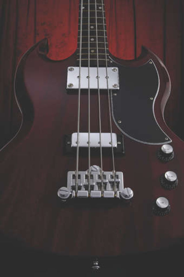 The SG has a slim body and short scale length