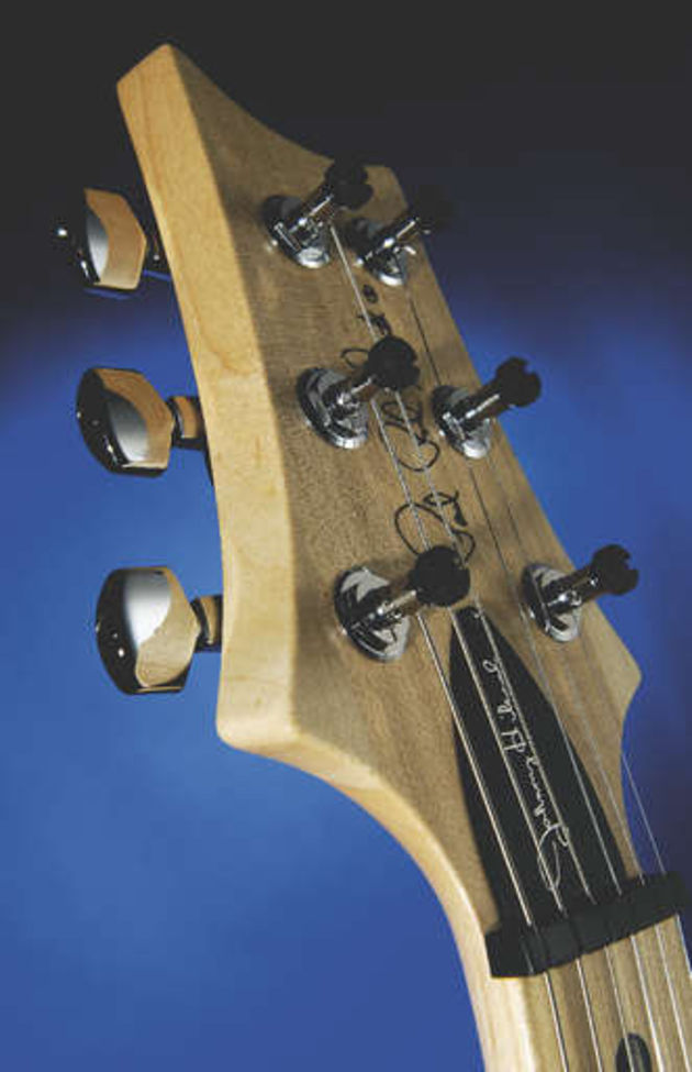 The truss rod cover is flush-mounted to facilitate behind-the-nut bends