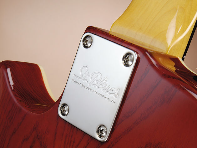 The neck is fixed standard-style with four machine screws and rectangular plate