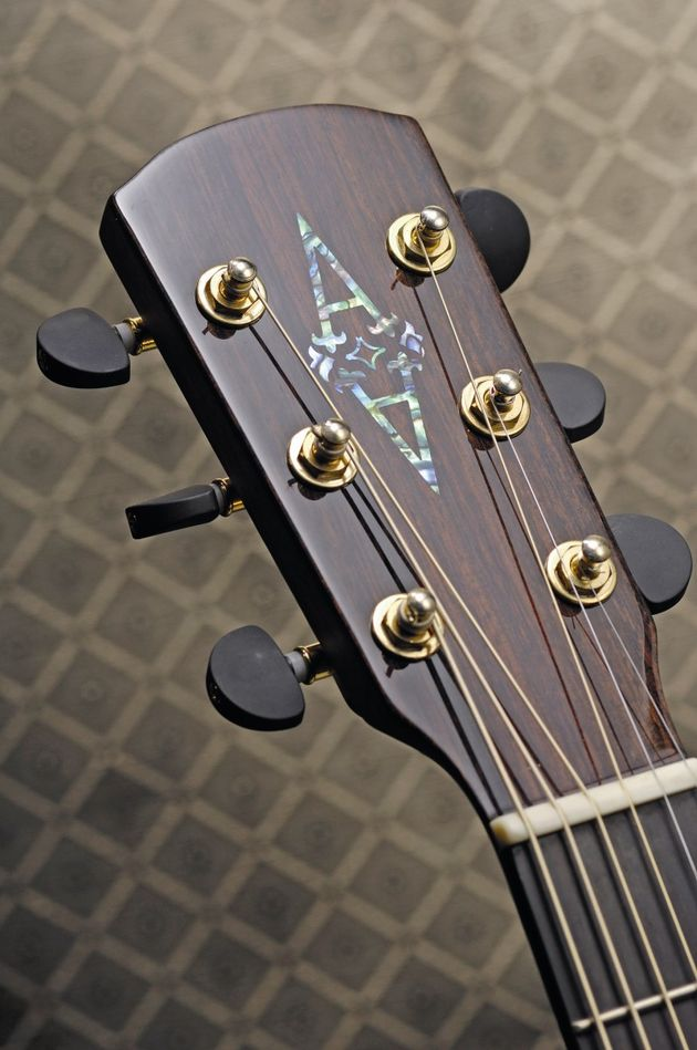 The headstock is adorned with subtle but high quality hardware