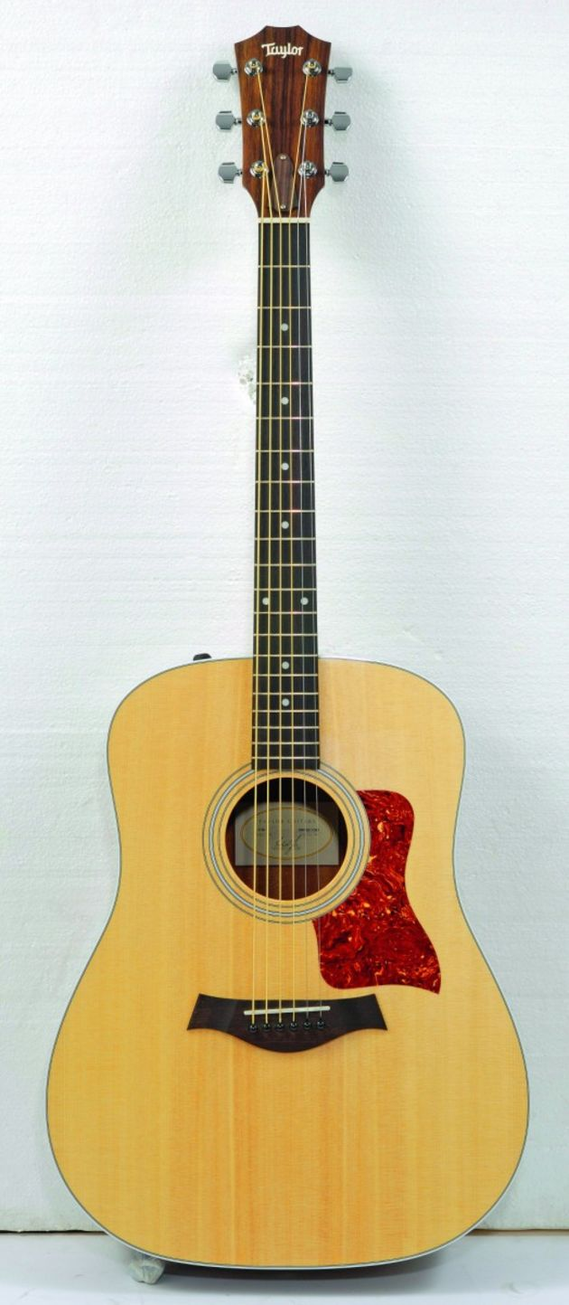 The 210 E's neck has a finger-jointed headstock