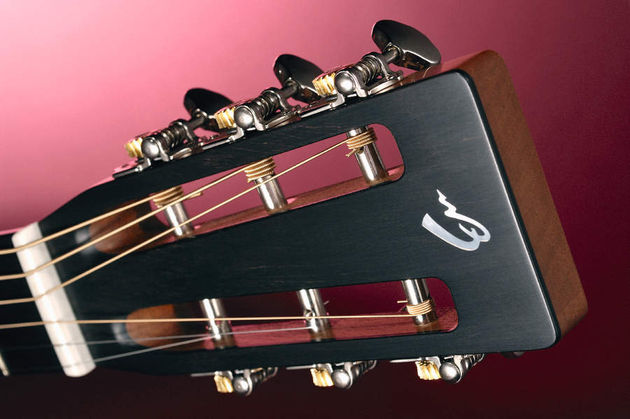 The 000R's slot headstock with open geared tuners.