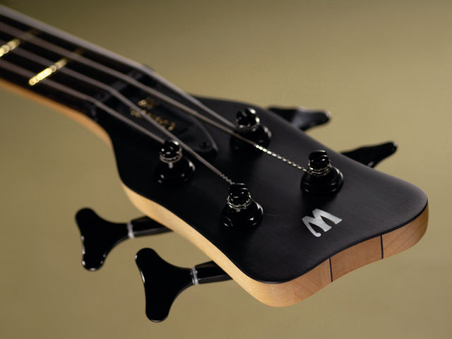 The Double Buck's headstock has Warwick's signature down-angled tuners