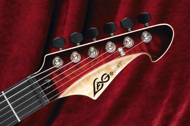 The two-tone stepped headstock is a stylish addition to the Jet.