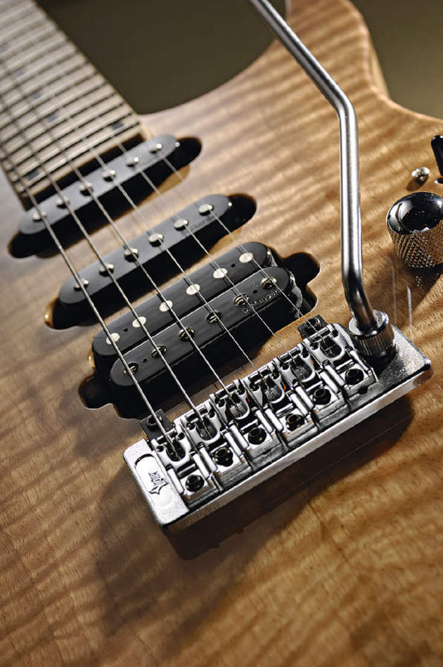 The Excalibur has a Schaller bridge and DiMarzio pickups.