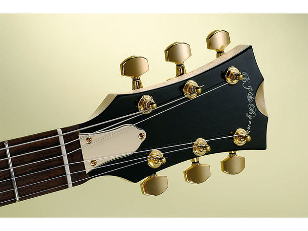 The headstock front is lacquered to match the body and topped with Gotoh tuners.
