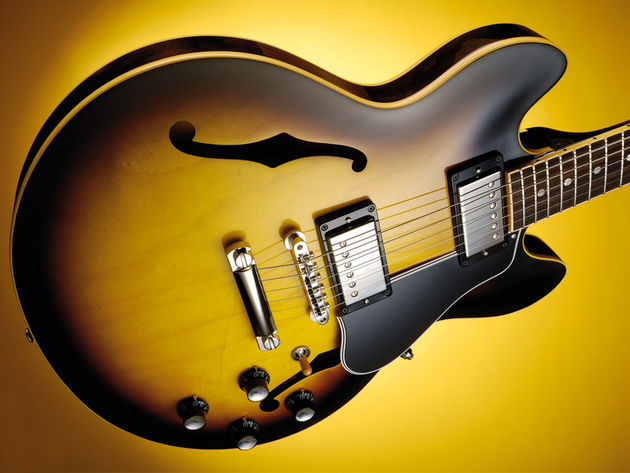 The ES-339 top is laminate maple and poplar which is pressed and lightly arched
