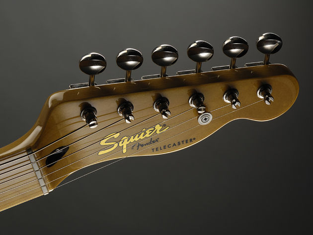 The simple, uncluttered headstock
